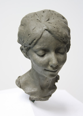 clay portrait sculpture of a young woman